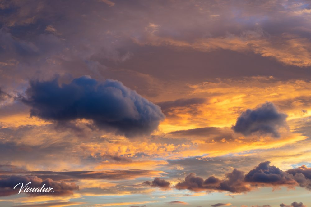 floating in the clouds, skyscape at sunset