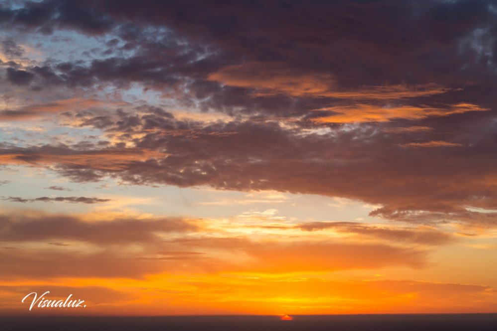 floating in the clouds, skyscape at sunrise